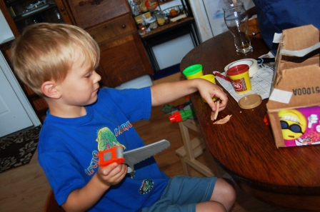 """Making playdough furniture for the cardboard house he just """"built"""""""