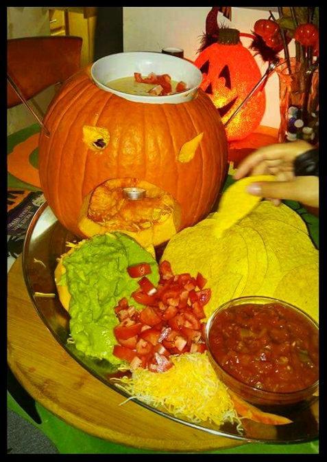 "Guac ""barf"" and warm Queso dip ""brains"" in a  pumpkin chafing dish!"