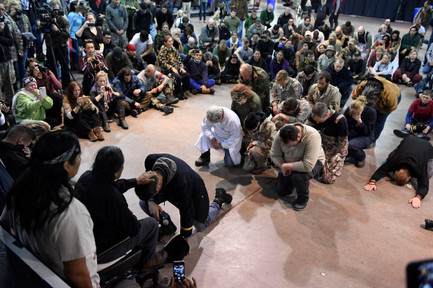 Gen. Wesley Clark Jr., kneels in front of Leonard Crow Dog, right, during a forgiveness ceremony at the Four Prairie Knights Casino & Resort on the Standing Rock Sioux Reservation on December 5, 2016 in Fort Yates, North Dakota. Native Americans conducted a forgiveness ceremony with U.S. veterans at the Standing Rock casino, giving the veterans an opportunity to atone for military actions conducted against Natives throughout history. The ceremony was held in celebration of Standing Rock protestersÕ victory SundayÊin halting construction on the Dakota Access Pipeline. Leonard Crow Dog formally forgave Wes Clark Jr., the son of retired U.S. Army general and former supreme commander at NATO, Wesley Clark Sr. Helen H. Richardson, The Denver Post