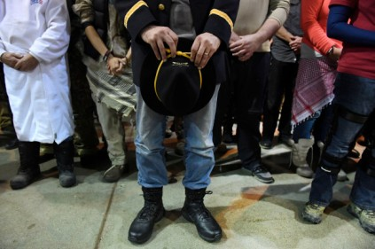 Gen. Wesley Clark Jr., middle, holds his calvary hat in prayer during an emotional forgiveness ceremony at the Four Prairie Knights Casino & Resort on the Standing Rock Sioux Reservation on December 5, 2016 in Fort Yates, North Dakota. Native Americans conducted a forgiveness ceremony with U.S. veterans at the Standing Rock casino, giving the veterans an opportunity to atone for military actions conducted against Natives throughout history. The ceremony was held in celebration of Standing Rock protestersÕ victory SundayÊin halting construction on the Dakota Access Pipeline. Helen H. Richardson, The Denver Post