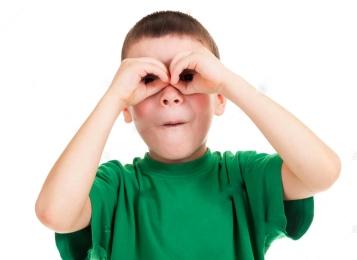 boy-looks-through-his-hands-like-binoculars-ERHXBA.jpg